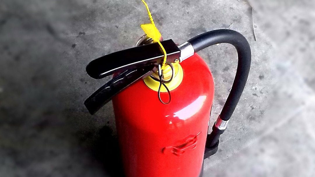 a fire extinguisher as an example of the many sizes of fire extinguishers