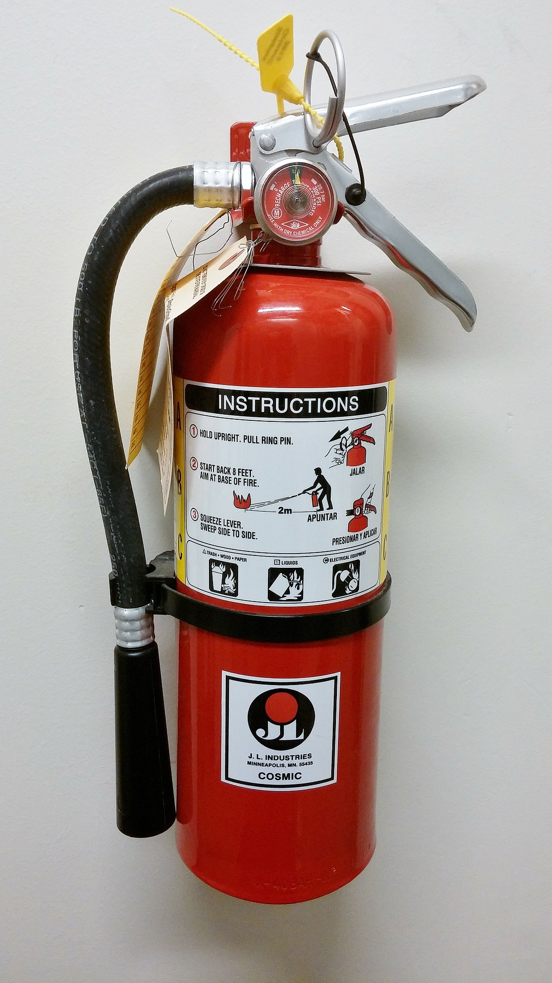 a fire extinguisher mounted on a wall